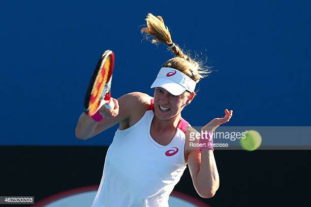 Alison Riske of the United States plays a forehand in her first round match against Elena Vesnina of Russia during day one of the 2014 Australian...