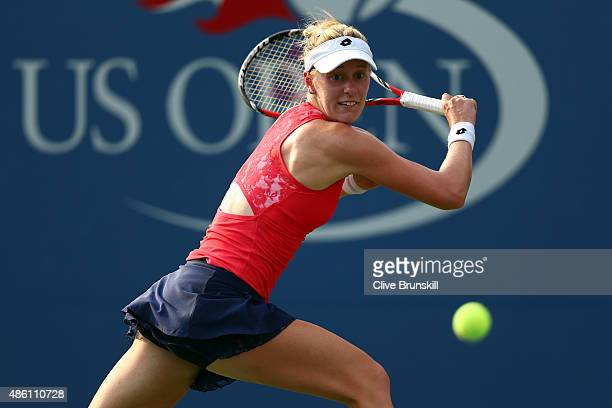 Alison Riske of the United States returns a shot against Eugenie Bouchard of Canada during their Woman's Singles First Round match on Day One of the...