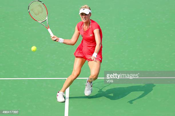 Alison Riske of the United States returns a shot against Sloane Stephens of the United States during day two of the 2015 Wuhan Open at Optics Vally...