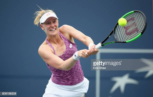 Alison Riske of the United States returns a shot to Anastasia Pavlyuchenkova of Russia during Day 4 of the Bank of the West Classic at Stanford...