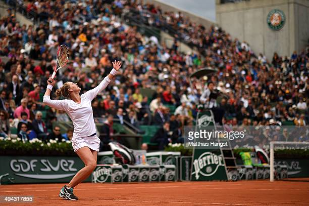 Alison Riske of the United States serves during her women's singles match against Kristina Mladenovic of France on day five of the French Open at...