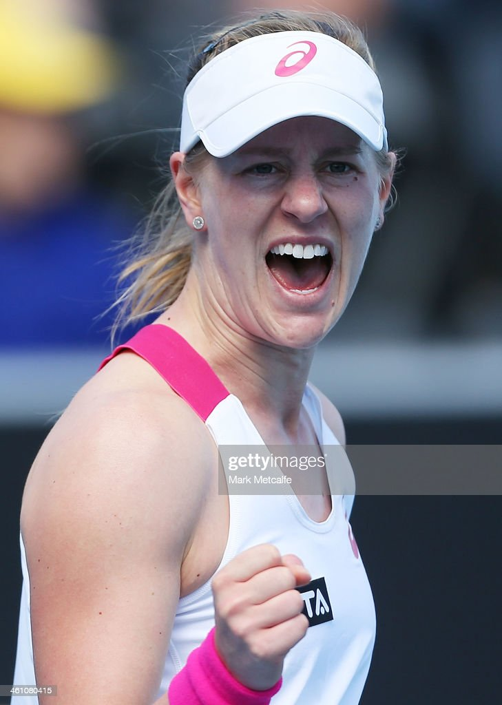 Alison Riske of the USA celebrates winning match point in her second round match against Casey Dellacqua of Australia during day three of the Moorilla Hobart International at Domain Tennis Centre on January 7, 2014 in Hobart, Australia.
