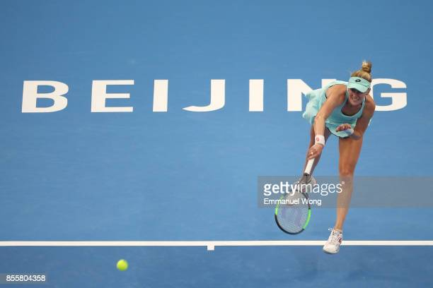 Alison Riske of the USA serves against Simona Halep of Romania on day one of the 2017 China Open at the China National Tennis Centre on September 30...