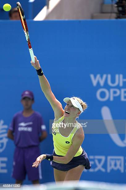 Alison Riske of US competes with Xu Shilin of China during day 1 of the 2014 Dongfeng Motor Wuhan Open at at Optics Valley International Tennis...