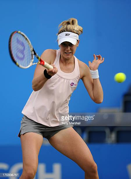 Alison Riske of USA returns a shot against Tamira Paszek of Austria during The AEGON Classic Tennis Tournament at Edgbaston Priory Club on June 11...