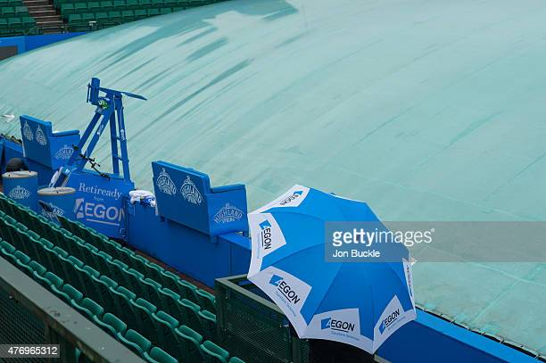A member of the security staff walks the grounds as rain falls at Nottingham Tennis Centre on June 13 2015 in Nottingham England NOTTINGHAM ENGLAND...