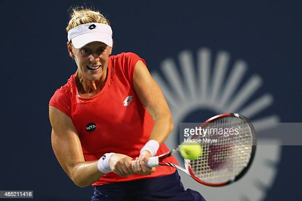 Alison Riske returns a backhand to Caroline Wozniaki of Denmark during day 2 of the Connecticut Open at Connecticut Tennis Center at Yale on August...
