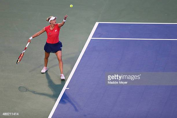Alison Riske serves to Caroline Wozniaki of Denmark during day 2 of the Connecticut Open at Connecticut Tennis Center at Yale on August 25 2015 in...