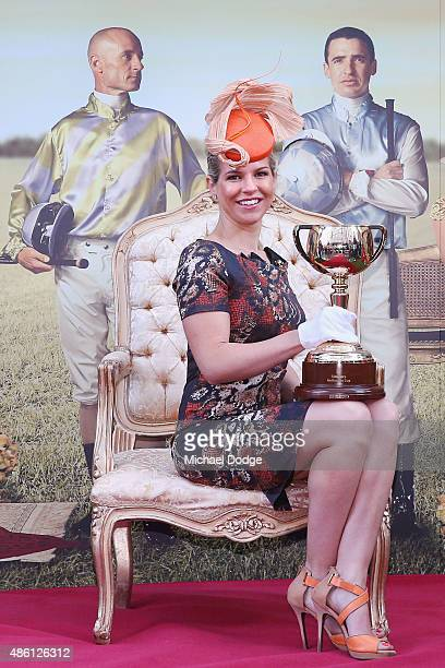 Alison Saville Black Caviar connection and former Myer Fashions on the Field ambassador poses with the Melbourne cup during the Melbourne Cup...