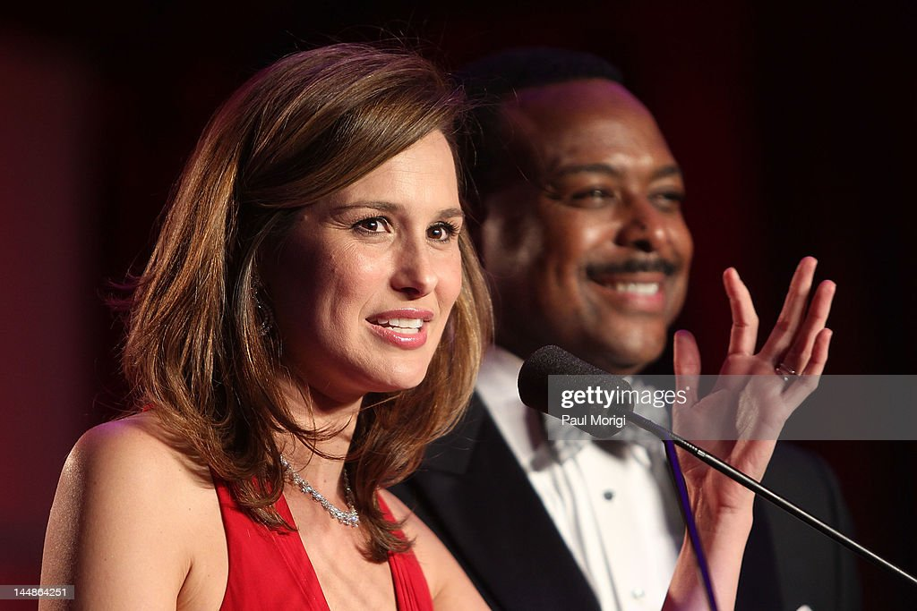 Alison Starling (L) speaks beside Leon Harris of WJLA on the podium during the 18th Annual Larry King Cardiac Foundation Gala at Ritz Carlton Hotel on May 19, 2012 in Washington, DC.