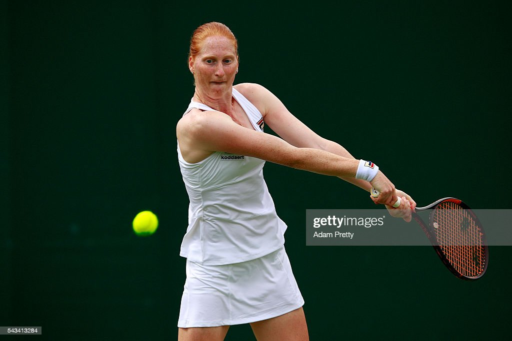 Alison Van Uytvanack of Belgium plays a backhand during the Ladies Singles first round match against Tara moore of Great Britain on day two of the Wimbledon Lawn Tennis Championships at the All England Lawn Tennis and Croquet Club on June 28, 2016 in London, England.