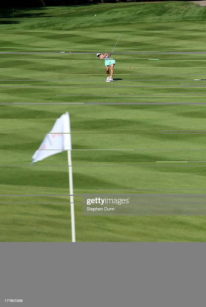 Alison Walshe hits from the sixth fairway during the third round of the CN Canadian Women's Open at Royal Mayfair Golf Club on August 24, 2013 in Edmonton, Alberta, Canada.