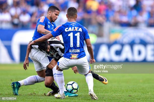 Alisson and Murilo of Cruzeiro and Brenner of Botafogo battle for the ball during a match between Cruzeiro and Botafogo as part of Brasileirao Series...