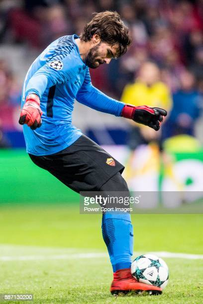 Alisson Becker goal keepers of AS Roma runs with the ball during the UEFA Champions League 201718 match between Atletico de Madrid and AS Roma at...