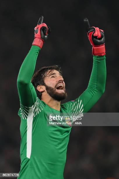 Alisson Becker of AS Roma celebrates after Edin Dzeko of AS Roma scores a goal to make it 22 during the UEFA Champions League group C match between...