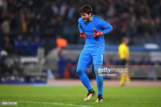 Alisson Becker of AS Roma celebrates after Stephan El Shaarawy of AS Roma scored his sides second goal during the UEFA Champions League group C match...
