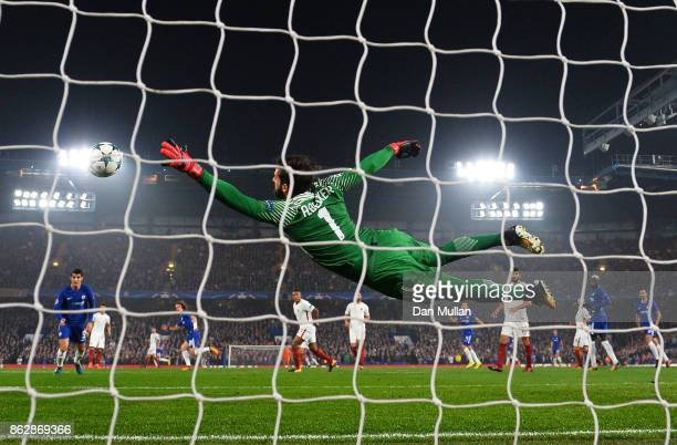 Alisson Becker of AS Roma dives but fails to stop David Luiz of Chelsea shot from going in for Chelsea first goal during the UEFA Champions League...