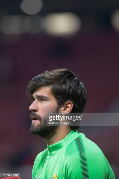 Alisson Becker of Roma looks on before the match between Atletico Madrid and AS Roma as part of the UEFA Champions League at Wanda Metropolitano...