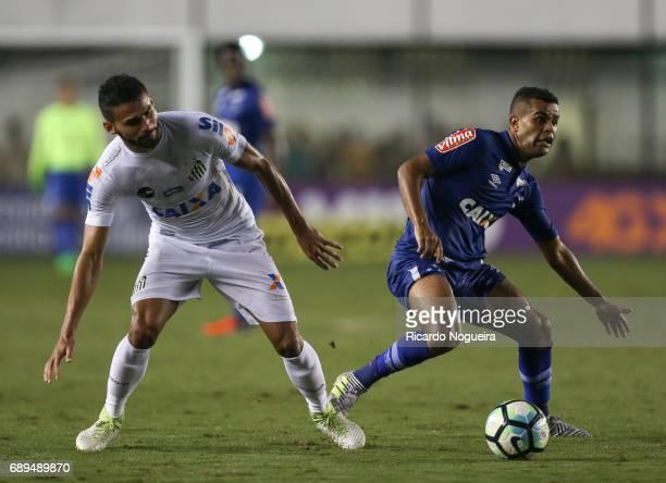 Alisson of Cruzeiro fights for the ball with Thiago Maia during the match between Santos and Cruzeiro as a part of Campeonato Brasileiro 2017 at Vila...