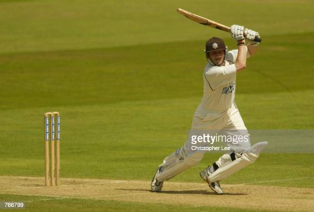 Alistair Brown of Surrey smashes the ball to the boundary on his way to a world record score of 268 during the Cheltenham and Gloucester Trophy One...