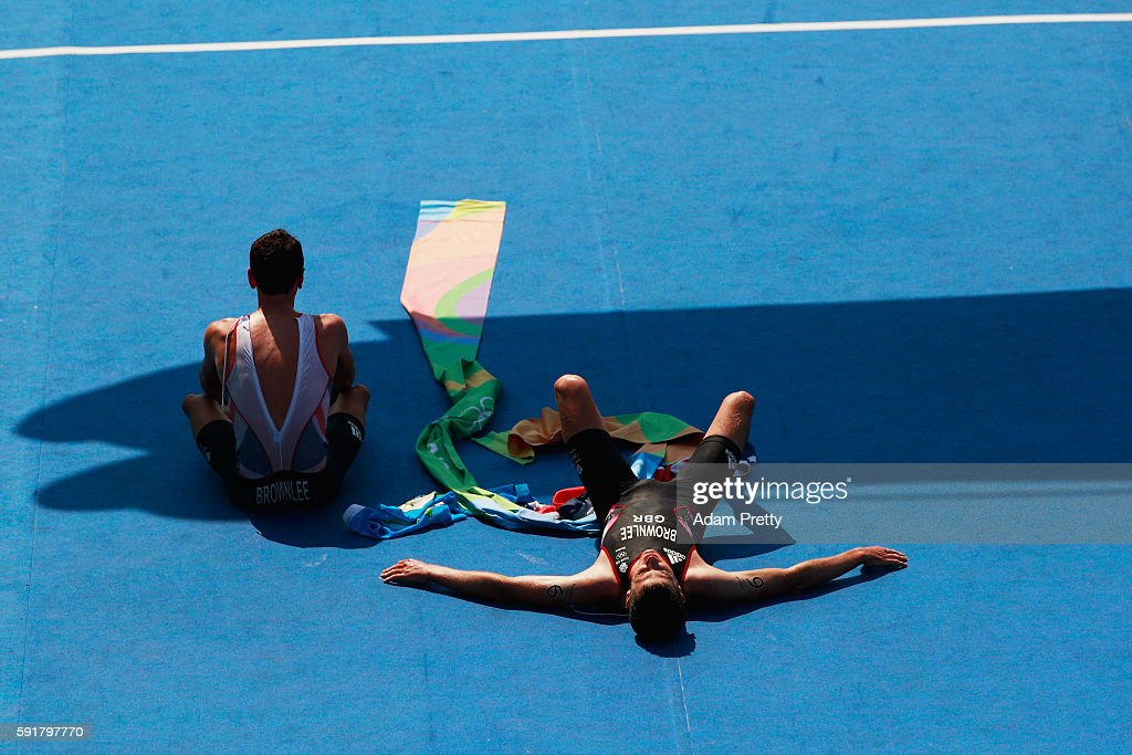 Alistair Brownlee and Jonathan Brownlee of Great Britain celebrate during the Men's Triathlon at Fort Copacabana on Day 13 of the 2016 Rio Olympic...