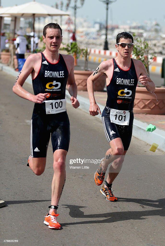 Alistair Brownlee and Jonathan Brownlee of Great Britain run during the Abu Dhabi International Triathlon on March 15 in Abu Dhabi United Arab...