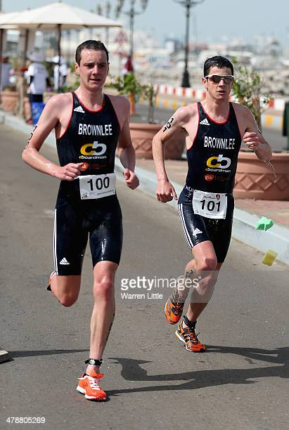 Alistair Brownlee and Jonathan Brownlee of Great Britain run during the Abu Dhabi International Triathlon on March 15 in Abu Dhabi United Arab...