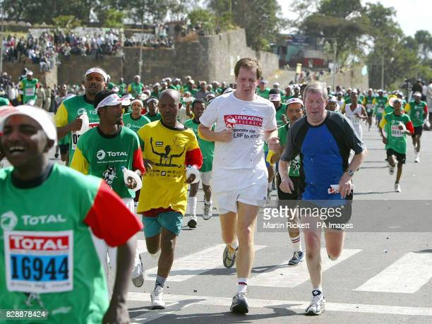 Alistair Campbell and Brendan Foster on the finishing straight after competing in the Great Ethiopian Run 2003 in Addis Ababa Ethiopia