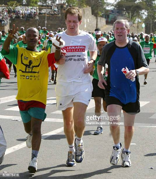 Alistair Campbell and Brendan Foster on the finishing straight of the Great Ethiopian Run 2003 in Addis Ababa Ethiopia
