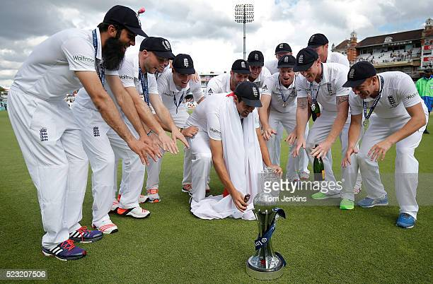 Alistair Cook and the rest of the England team do a 'Champions League like' celebration with the Ashes urn on their lap of honour after the match...