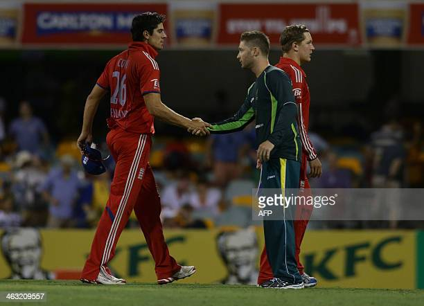 Alistair Cook of England congratulates his opposite number Michael Clarke of Australia after Australia won the second oneday international cricket...