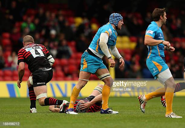Alistair Hargreaves of Saracens lies concussed and leaves the pitch a second time and final time after a tackled by James Haskell of London Wasps...