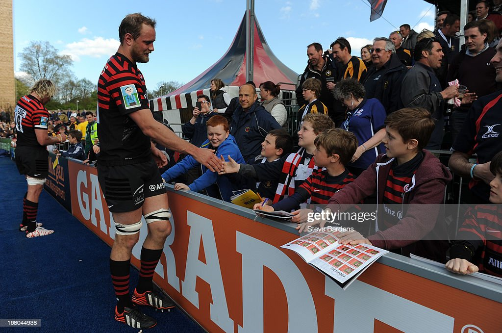 <a gi-track='captionPersonalityLinkClicked' href=/galleries/search?phrase=Alistair+Hargreaves&family=editorial&specificpeople=2488085 ng-click='$event.stopPropagation()'>Alistair Hargreaves</a> of Saracens shakes hands with young fans after the Aviva Premiership match between Saracens and Bath at Allianz Park on May 04, 2013 in Barnet, England.