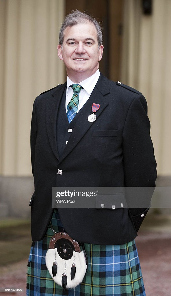 Alistair Neil poses after being awarded the George Medal for tackling an armed gunman on board HMS Astute, at Buckingham Palace on November 21, 2012 in London, England.