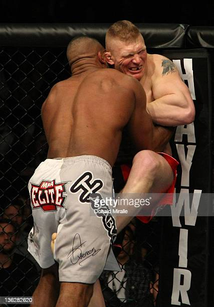 Alistair Overeem and Brock Lesnar struggle against the Octagon fence during the UFC 141 event at the MGM Grand Garden Arena on December 30 2011 in...