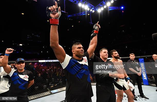 Alistair Overeem celebrates his victory over Andrei Arlovski in their heavyweight bout during the UFC Fight Night event at Ahoy Rotterdam on May 8...