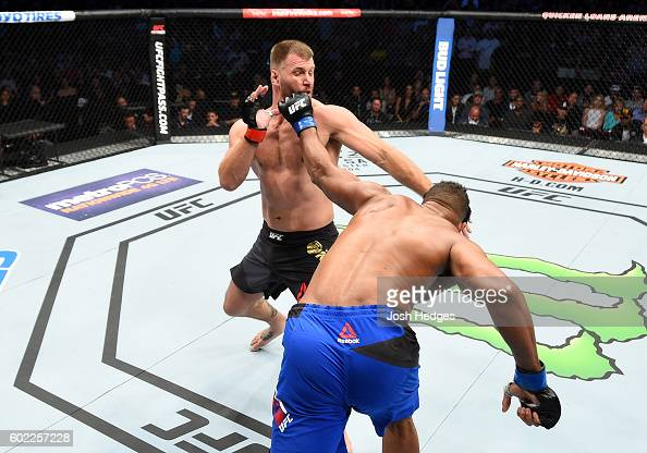 Alistair Overeem of The Netherlands punches Stipe Miocic in their UFC heavyweight championship bout during the UFC 203 event at Quicken Loans Arena...