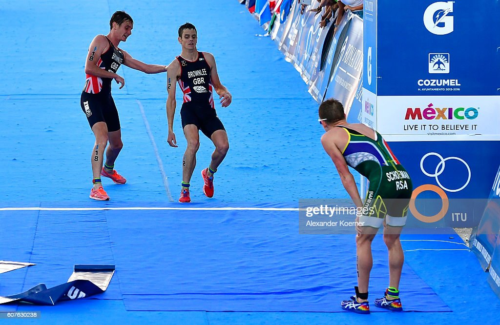Alistar Brownlee of Great Britain helps his brother Jonathan Brownlee (c) of Great Britain to cross the finished line as Jonathan collapsed of dehydration 200 meters before the finish line during the Men Elite ITU World Championship race at the Fonatur Triathlon Park on September 18, 2016 in Cozumel, Mexico. The medal ceremony was cancelled due to the critical condition of Jonathan Brownlee. The ITU Grand Final World Championship ends tonight.