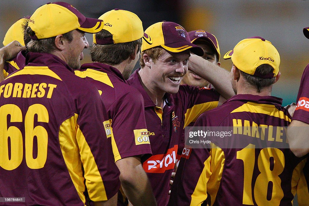 Alister McDermott of the Bulls celebrates with team mates after taking a catch to dismiss Moises Henriques of the Blues during the Ryobi One Day Cup match between the Queensland Bulls and the New South Wales Blues at The Gabba on November 21, 2012 in Brisbane, Australia.