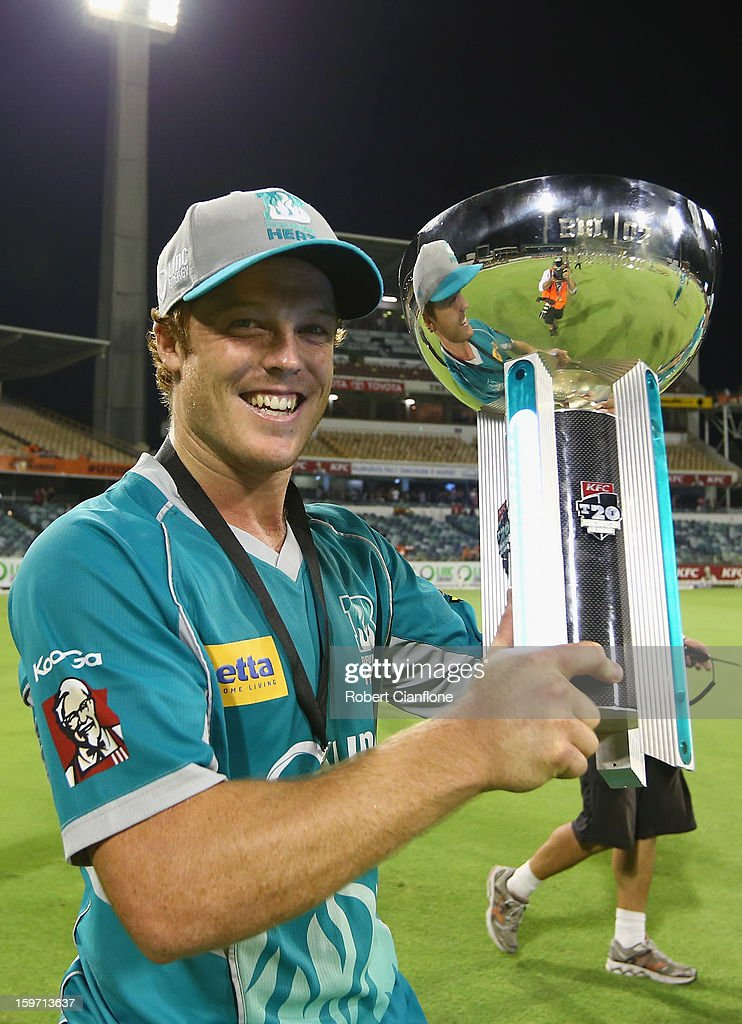 Alister McDermott of the Heats holds the winner's trophy after the Heat defeated the Scorchers in the Big Bash League final match between the Perth Scorchers and the Brisbane Heat at the WACA on January 19, 2013 in Perth, Australia.