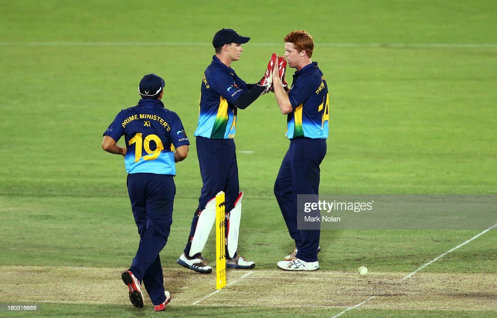 Alister McDermott of the PM's XI is congratulated after taking a catch to dismiss Devon Thomas of the West Indies during the International Tour Match between the Prime Minister's XI and West Indies at Manuka Oval on January 29, 2013 in Canberra, Australia.