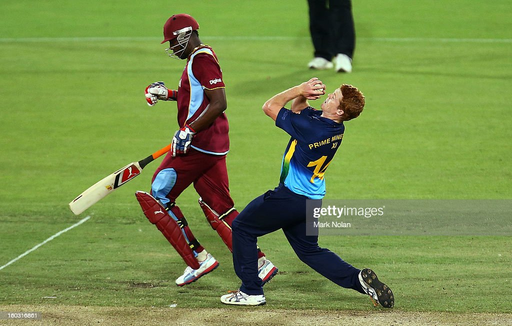 Alister McDermott of the PM's XI takes a catch to dismiss Devon Thomas of the West Indies during the International Tour Match between the Prime Minister's XI and West Indies at Manuka Oval on January 29, 2013 in Canberra, Australia.