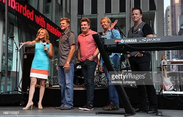 Alisyn Camerota interviews members of the band Lonestar during 'FOX Friends' All American Concert Series outside of FOX Studios on May 31 2013 in New...