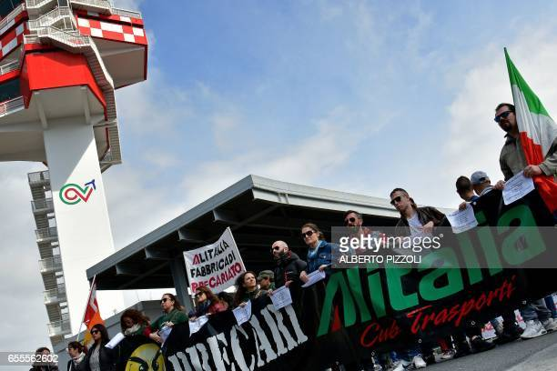Alitalia air transport employees takes part in a protest rally on March 20 2017 at Rome's Fiumicino airport Air traffic in Italy was being disrupted...