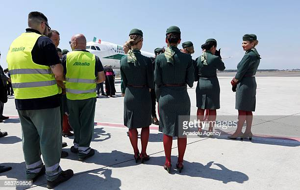 Alitalia hostesses are seen after departure of Pope Francis from Rome to Poland' s Krakow where he will attend the World Youth Day at Fiumicino...