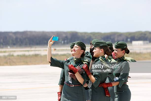 Alitalia members take a selfie after departure of Pope Francis from Rome to Poland' s Krakow where he will attend the World Youth Day at Fiumicino...