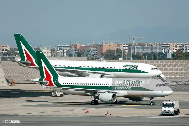 Alitalia SpA aircraft stand on the tarmac at Fiumicino airport in Rome Italy on Friday April 17 2015 Etihad bought a 49 percent stake in Alitalia...