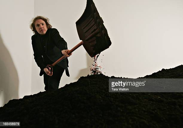 ALIVE02/04/07Austrian artist Johannes Grenzfurther piles dirt on top of the casket after closing the lid on reporter Erin Kobayashi Star reporter...