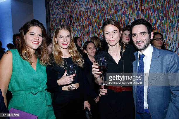 Alix Duvernoy Eugenie Niarchos Coowner of the Gallery Victoire de Pourtales and her husband Benjamin Eymere attend the 'A Moment of Reconstruction'...