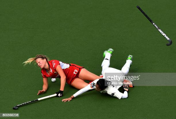 Alix Gerniers of Belgium is fouled by Nurul Mansur of Malaysia during the FINTRO Women's Hockey World League SemiFinal Pool B game between Belgium...